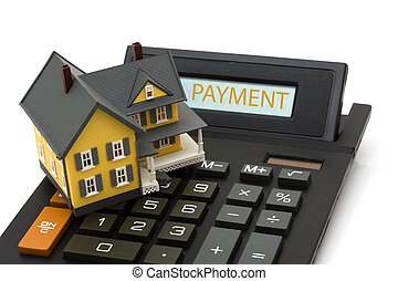 A house sitting on a calculator isolated on white, Mortgage calculator