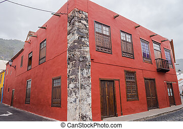 A house with red facade of Canarian architecture on the island of Tenerife in Spain