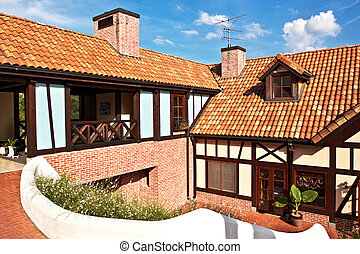 A house with red tile roof