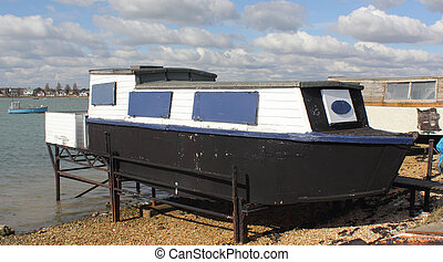 houseboat - A houseboat in portsmouth harbour in england