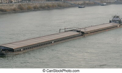 A huge barge floats on the Danube River. - A huge barge...