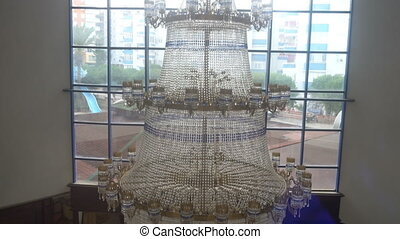 a huge crystal chandelier in the hotel,the view from the Elevator