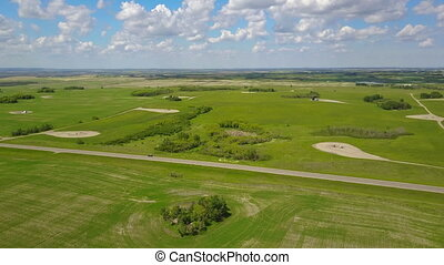 A huge and empty piece of land in a suburban area, which looks beautiful from above. A beautiful landscape of a field area