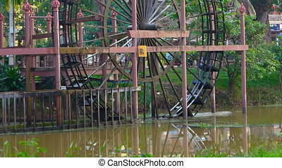 A huge waterwheel on the River. Cambodia, Siem Reap. Video...