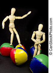 humanoid couple playing with brightly colored balls