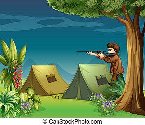 A hunter in a campsite