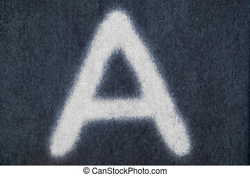 A isolated chalk letter in blackboard background