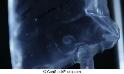 A IV fluid bag shot - A close up shot of a intravenous fluid...