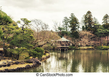 Japanese Garden and koi carps in the pond.