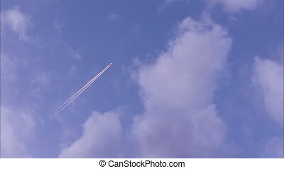 A jet plane on the sky - A worm's eye view shot of a jet...