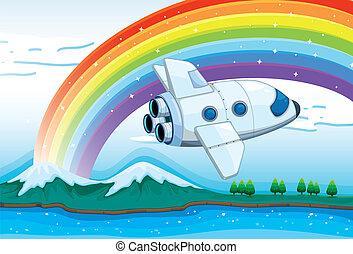 A jetplane near the rainbow