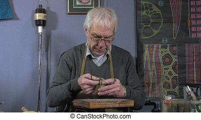 a jeweler creates a bracelet