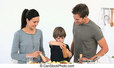 A joyful family cooking together