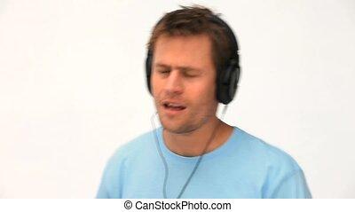 A joyful man listening to music and dancing