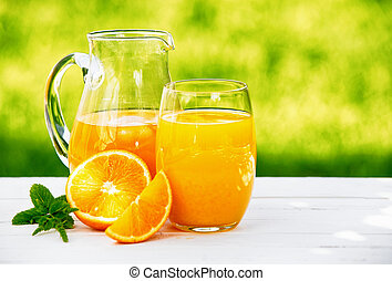 A jug and glass of fresh orange juice