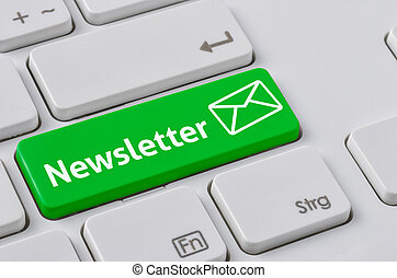 A keyboard with a green button - Newsletter