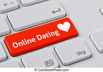 A keyboard with a red button - Online Dating