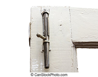 A keyhole on a gray door.