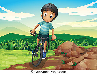 A kid biking at the hilltop