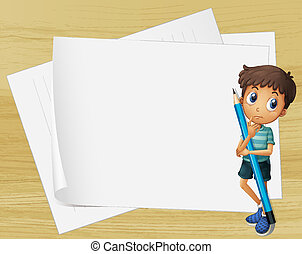 A kid holding a pencil beside the empty papers