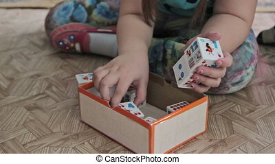 A kid playing toy blocks