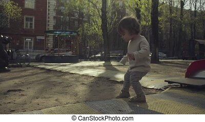 A kid walking in the courtyard