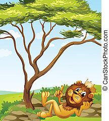 A king lion lying down near the tree