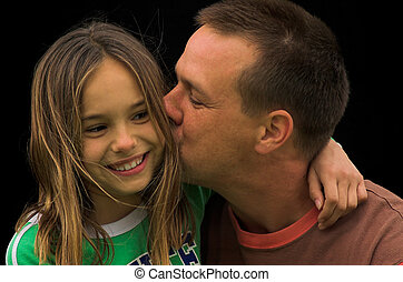 A Kiss - A father kissing his daughter on the cheek