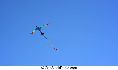 a kite in the sky on a clear day
