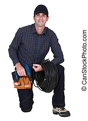 A kneeled electrician.