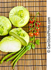 a Kohlrabi, tomatoes and young peas