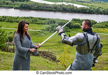 A lady in chain mail and a knight in armor