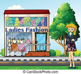 A lady in front of the ladies fashion store