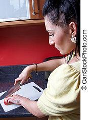 A lady preparing food