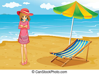 A lady wearing a pink dress at the beach