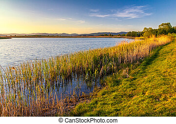 A lake at sunset in a spring-time.