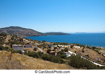 A lake surrounded by hills on a sunny day in Aegean, Izmir,...
