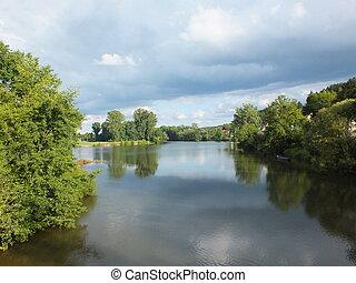 A lake with greenery