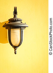 A Lamp with shadow on a wall background.