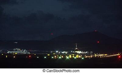 A landing aircraft at night