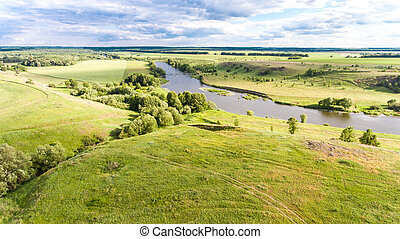 A landscape of hills with a river