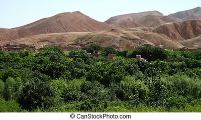 A landscape of vegetation and mountains - A steady, long...