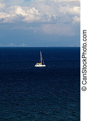 Peloponnese, Greece - A landscape with a sailboat in ...