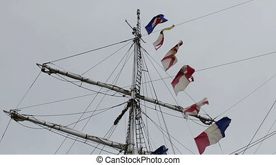 A large antique wooden yacht with the flags of Europe. Sines Portugal
