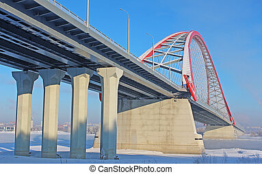 A large arch bridge in the cold winter