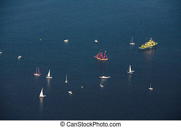 A large cluster of sailboats and yachts in the mouth of the ...