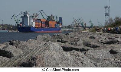 A large loaded cargo ship enters the port of Klaipeda. Lithuania
