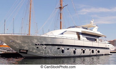 a large luxury yacht in marseille's vieux port harbour,...