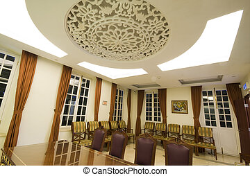 A large mahogany conference room table with leather chars