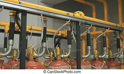 A large number of gas cylinders are connected to a single...